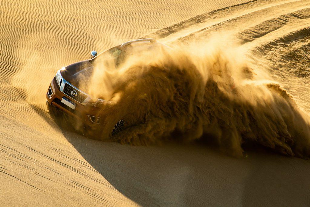 A Nissan Qashqai driving through dunes