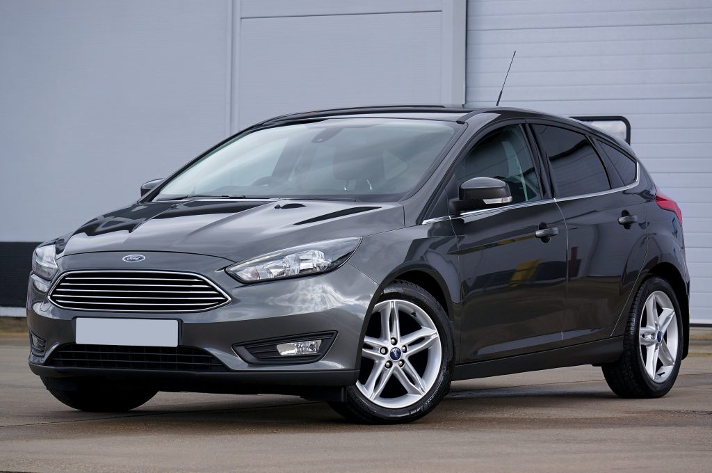 A charcoal Ford Focus with shiny car glass and a fresh windscreen replacement