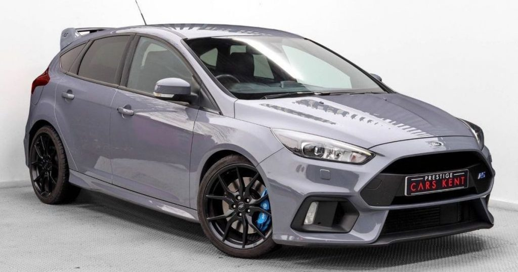 Race-car version of a Ford Focus in light purple colouring