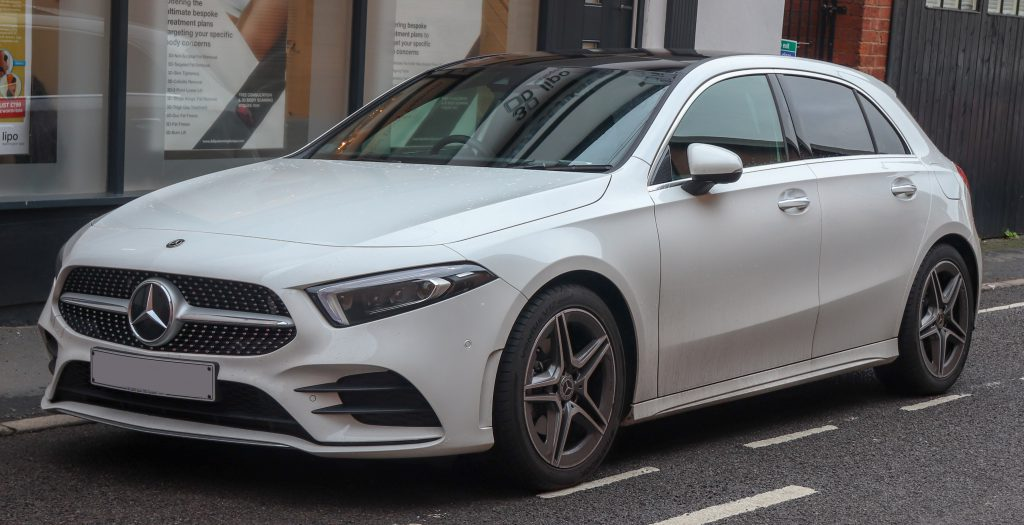 A white Mercedes A-Class on the street. Rated as number 5 most popular car in the UK