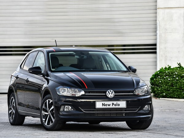 Black Volkswagen Polo with racing stripe and new windscreen replacement