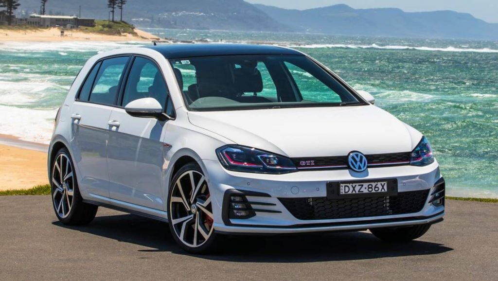 A white Volkswagen Golf which has been rated the number 3 most popular car in the UK