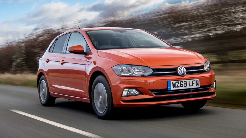 Orange Volkswagen Polo driving outside after new windscreen replacement