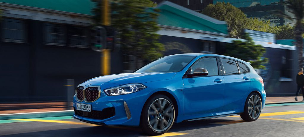 Blue BMW 1 Series on the road