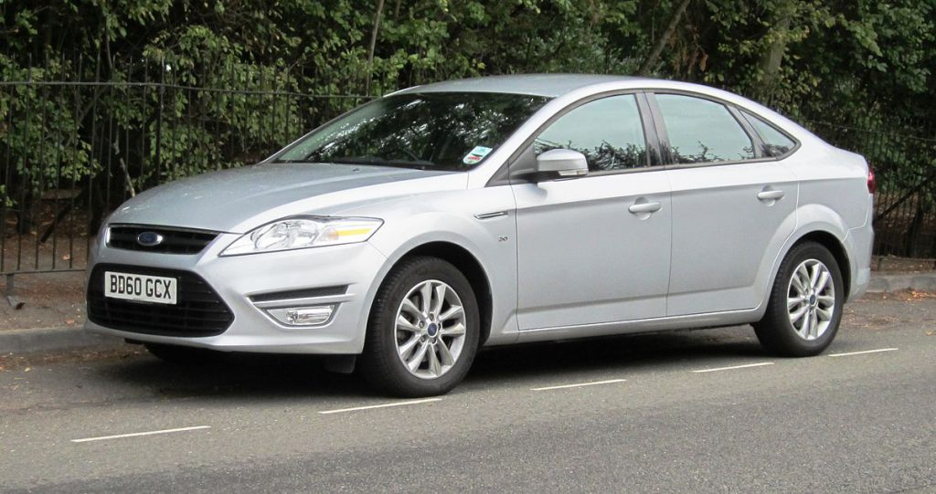 Silver Ford Mondeo parked on the road