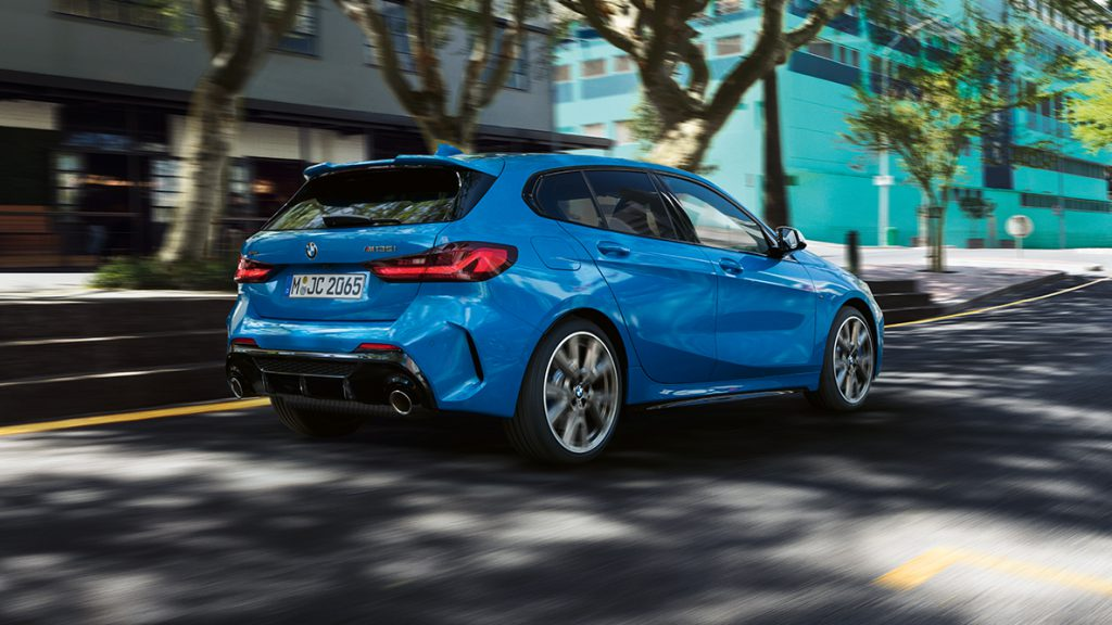 Rear view of a blue BMW 1 Series on the road