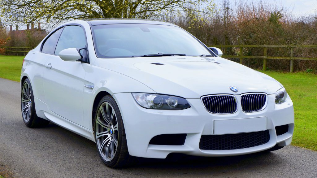 White  BMW 1 Series on the countryside road
