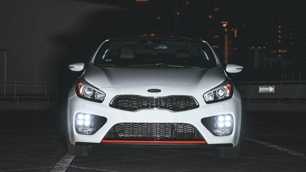 White KIA Sportage at night