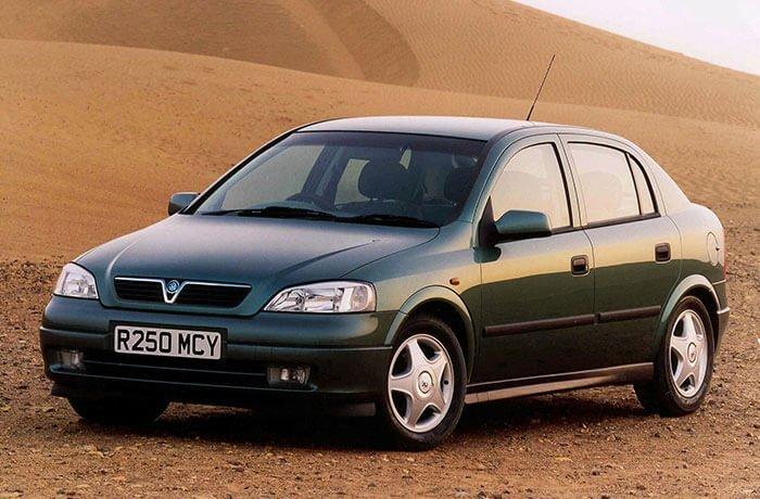Older green model of a Vauxhall Astra in the desert