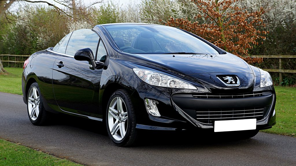 Black sporty Peugeot 207 after a  Windscreen Replacement outside