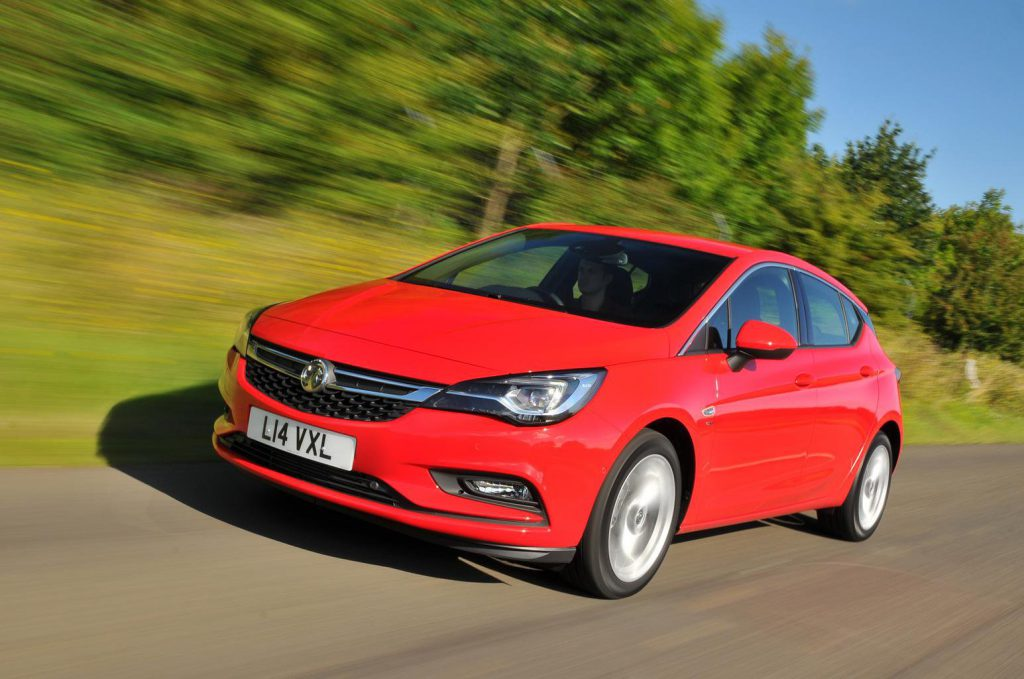 Red Vauxhall Astra on the road