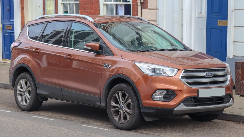 Orange Ford Kuga on street outside, after a fresh windscreen replacement