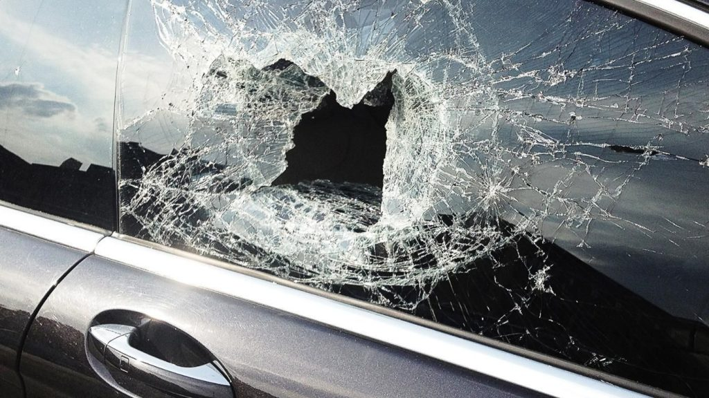 Smashed side window of a car, needing a glass replacement
