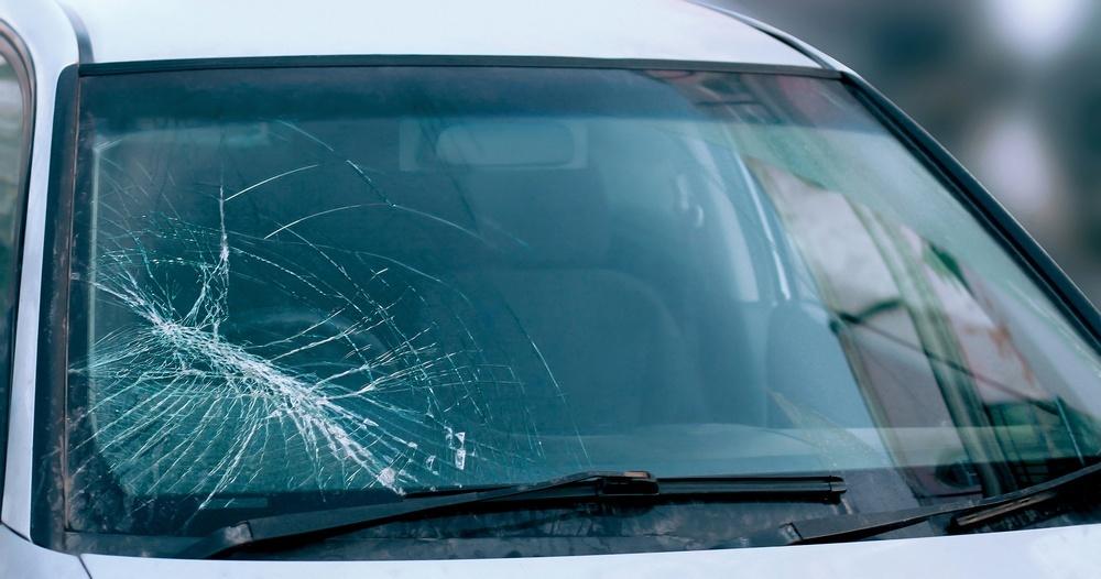Car glass windscreen crack spreading further on a windscreen