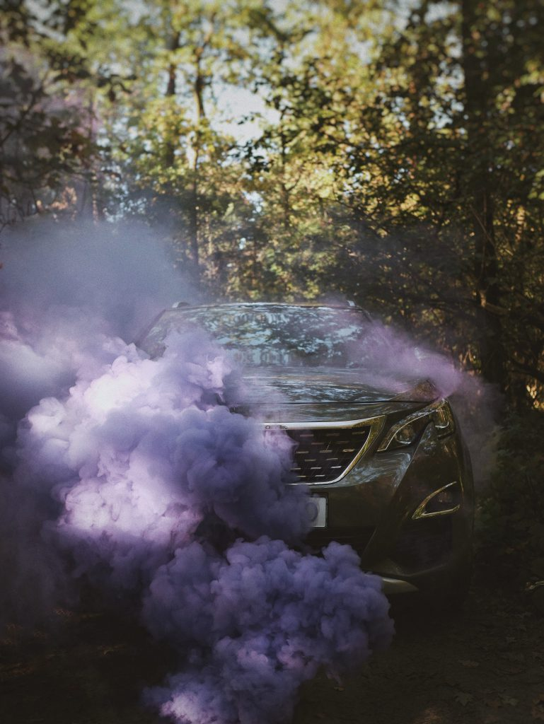 Purple smoke hiding a Peugeot 208 with a brand new windscreen replacement