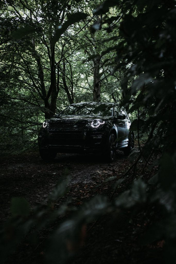 Black Land Rover Discovery in the wild after a new windscreen replacement
