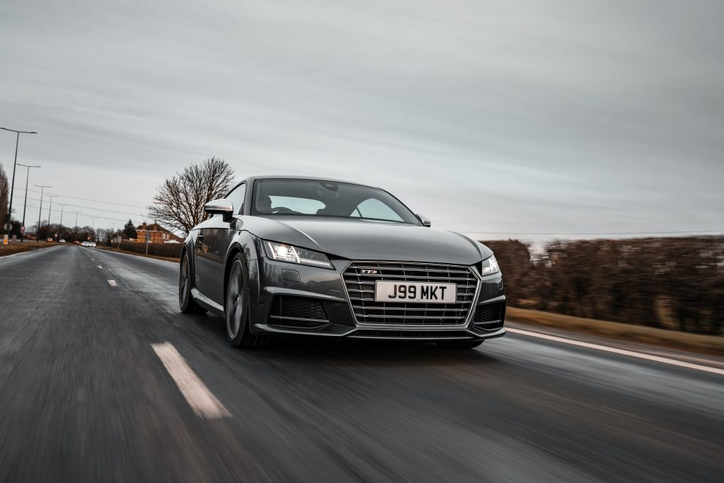 Black Audi TT on the road after new windscreen replacement