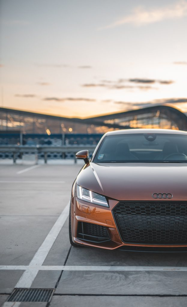 Burned Orange Audi TT outside after new windscreen replacement