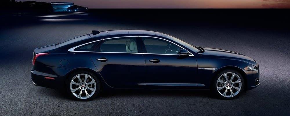 Midnight Blue Jaguar XJ on the street