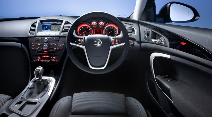 Interior shot with steering wheel and emblem