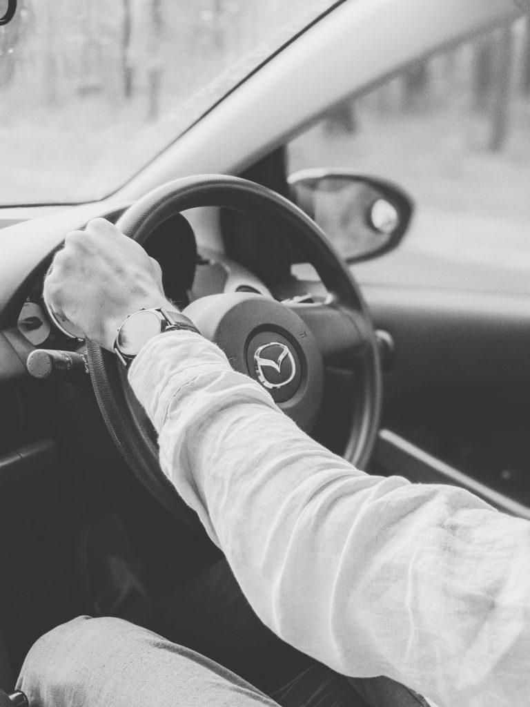 Interior shot with mazda steering wheel and windscreen