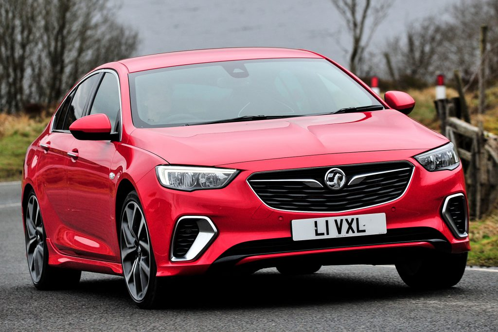 Red Vauxhall Insignia on the road after fresh car glass replacements