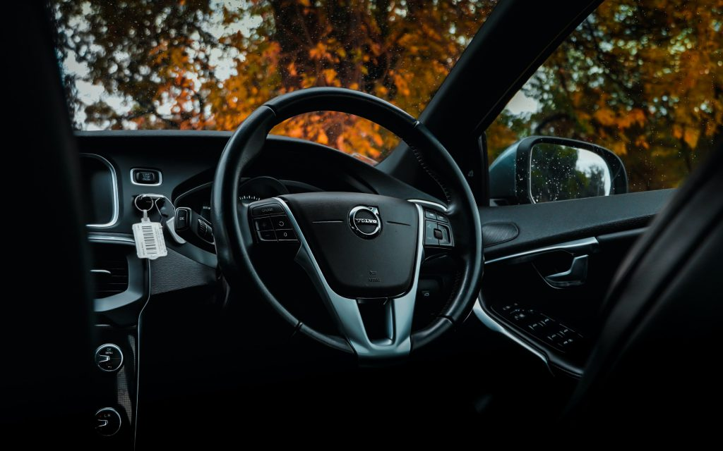 Interior shot of a Volvo with steering wheel and windscreen.